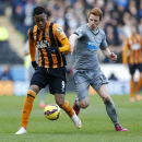 Newcastle United's Jack Colback, right, and Hull City's Abel Hernandez battle for the ball during their English Premier League match at the KC Stadium, Hull England Saturday Jan. 31, 2015