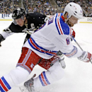 New York Rangers' Kevin Klein, right, beats Pittsburgh Penguins' Sidney Crosby to the puck during the second period of an NHL hockey game, Sunday, Jan. 18, 2015, in Pittsburgh. The Rangers won 5-2 The Associated Press