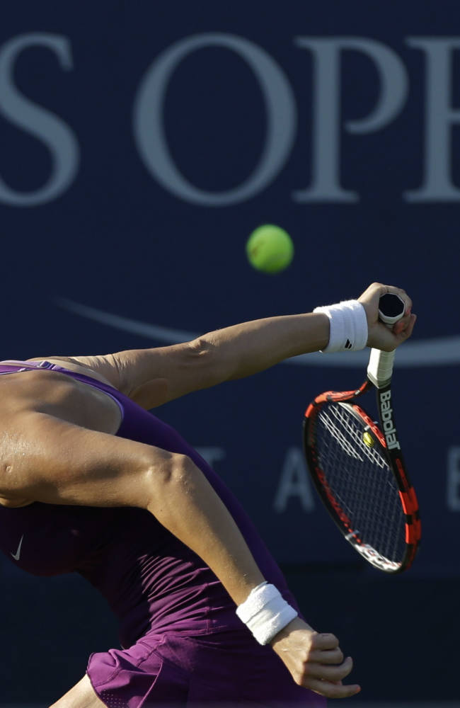 Mirjana Lucic-Baroni, of Croatia, misses a shot against Garbine Muguruza, of Spain, during the opening round of the 2014 U.S. Open tennis tournament, Monday, Aug. 25, 2014, in New York