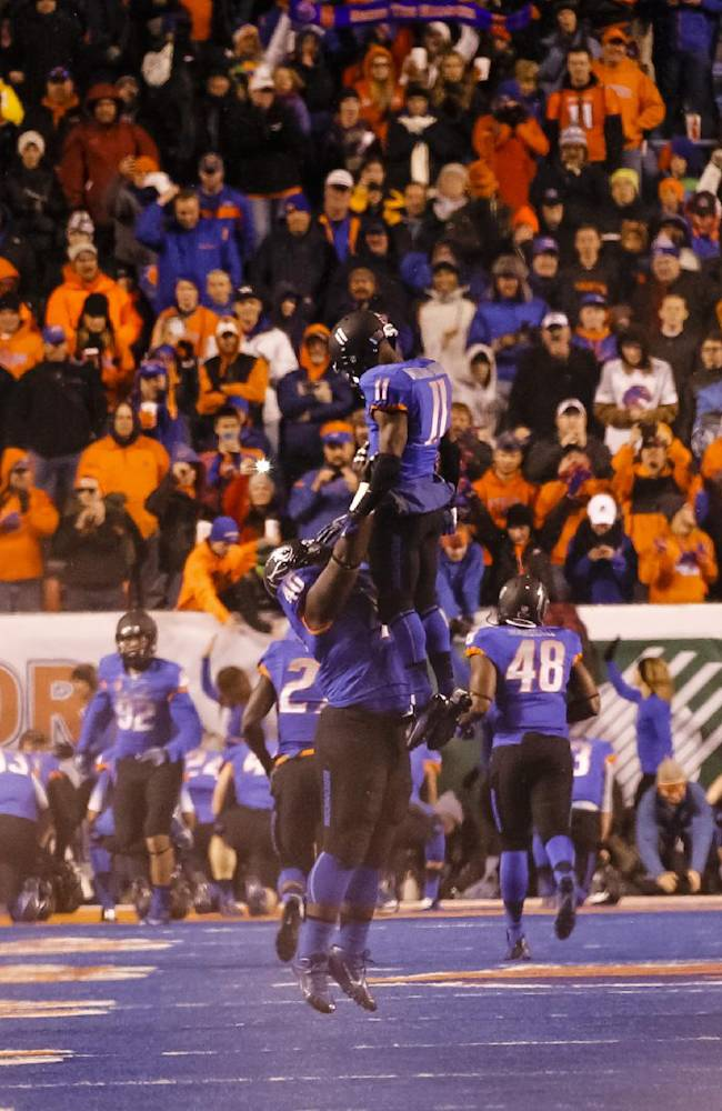 Boise State's Armand Nance (40) throws Shane Williams-Rhodes (11) up in the air before an NCAA college football game against Wyoming in Boise, Idaho, Saturday, Nov. 16, 2013. Boise State beat Wyoming 48-7