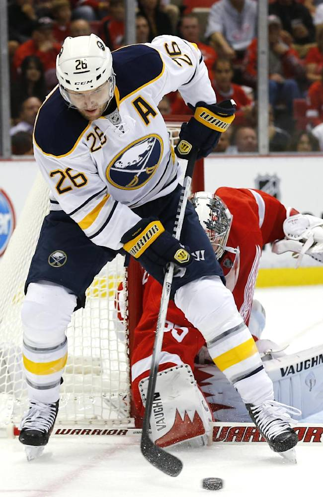 Buffalo Sabres left wing Thomas Vanek (26) tries to control the puck in front of Detroit Red Wings goalie Jimmy Howard (35) during the first period of an NHL hockey game on Wednesday, Oct. 2, 2013, in Detroit