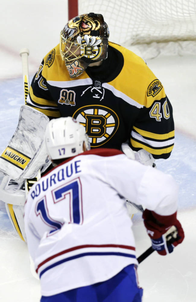 Boston Bruins goalie Tuukka Rask (40) misses a shot by Montreal Canadiens left wing Rene Bourque (17) during the second period of Game 1 in the second-round of a Stanley Cup playoff series in Boston, Thursday, May 1, 2014