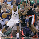 Portland Trail Blazers' LaMarcus Aldridge, right, guards Utah Jazz's Derrick Favors (15) in the second quarter during an NBA basketball game on Friday, April 11, 2014, in Salt Lake City. (AP Photo/Rick Bowmer)