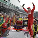Kyle Busch (18) celebrates after winning the NASCAR Brickyard 400 auto race at Indianapolis Motor Speedway in Indianapolis, Sunday, July 26, 2015. (AP Photo/Michael Conroy)