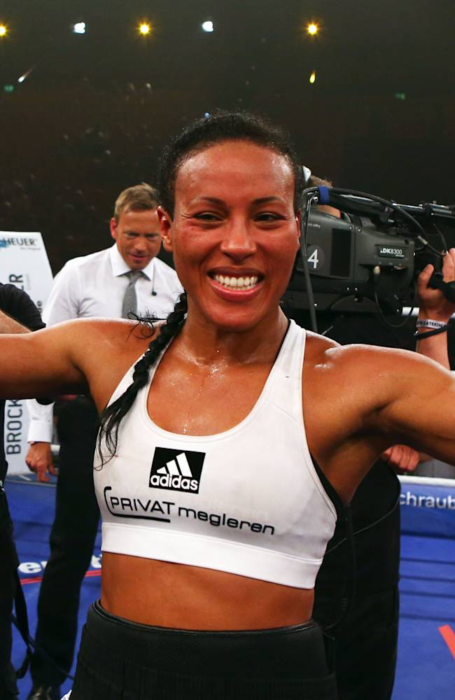 In this picture taken Saturday June 7, 2014, Colombian-born Norwegian ,Cecilia Braekhus, celebrates after she won her   women's welterweight  world championships title bout against Nigerian-born German boxer Jessica Balogun in Schwerin, eastern Germany