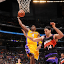 LOS ANGELES, CA - FEBRUARY 12: Antawn Jamison #4 of the Los Angeles Lakers rises for a dunk against Luis Scola #14 of the Phoenix Suns at Staples Center on February 12, 2013 in Los Angeles, California. (Photo by Andrew D. Bernstein/NBAE via Getty Images)