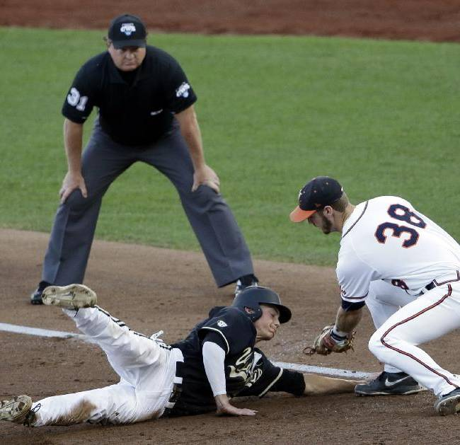 Vanderbilt's Bryan Reynolds (20) slides safely back to first base against Virginia first baseman Mike Papi during the third inning of the last game of the best-of-three NCAA baseball College World Series finals in Omaha, Neb., Wednesday, June 25, 2014