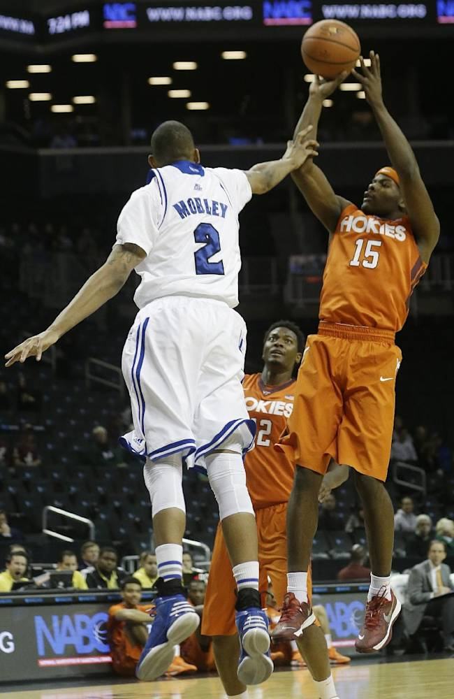 Virginia Tech's Ben Emelogu (15) shoots over Seton Hall's Brandon Mobley (2) during the first half of a consolation game in the Coaches vs. Cancer NCAA college basketball game on Saturday, Nov. 23, 2013, in New York