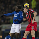 Everton's Romelu Lukaku, left, fights for the ball against Queens Park Rangers' Richard Dunne during the English Premier League soccer match between Everton and Queens Park Rangers at Goodison Park Stadium, Liverpool, England, Monday Dec. 15, 2014