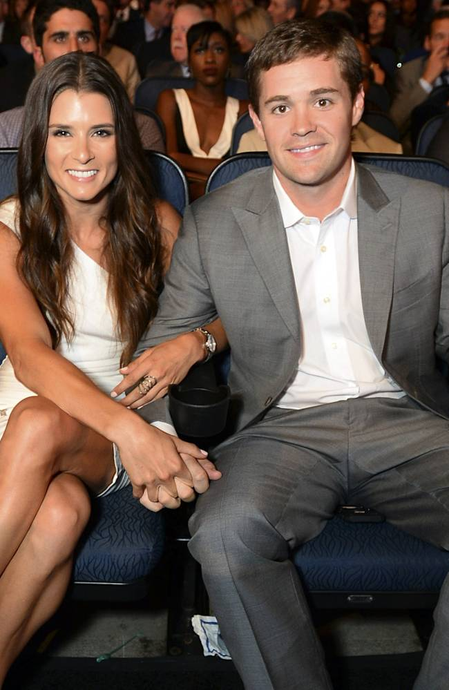 Racers Danica Patrick, left, and Ricky Stenhouse Jr. pose in the audience at the ESPY Awards at the Nokia Theatre on Wednesday, July 16, 2014, in Los Angeles. (Photo by Jordan Strauss/Invision/AP)