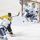 Nashville Predators center Craig Smith (15) scores a goal against Vancouver Canucks goalie Eddie Lack (31), of Sweden, in the first period of an NHL hockey game Tuesday, Jan. 13, 2015, in Nashville, Tenn The Associated Press