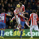 Stoke City's Ryan Shawcross, centre left, and Peter Crouch, TOP, battle in the air with Crystal Palace's Brede Hangeland, centre right, during their English Premier League soccer match at Selhurst Park, London, Saturday Dec. 13, 2014