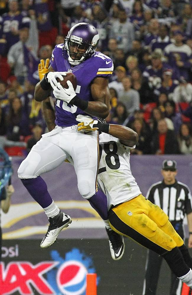Minnesota Vikings wide receiver Greg Jennings (15), catches the ball in the end zone to score a touchdown despite the challenge of Pittsburgh Steelers cornerback Cortez Allen (28) during their NFL football game at Wembley Stadium, London, Sunday, Sept. 29, 2013