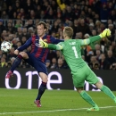 Barcelona's Ivan Rakitic, left, shoots to score past Manchester City's goalkeeper Joe Hart, left, during a Champions League round of 16 second leg, soccer match between FC Barcelona and Manchester City at Camp Nou stadium, in Barcelona, Spain, Wednesday,