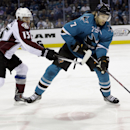 San Jose Sharks' Brad Stuart (7) controls the puck next to Colorado Avalanche's P.A. Parenteau (15) during the second period of an NHL hockey game on Friday, April 11, 2014, in San Jose, Calif The Associated Press