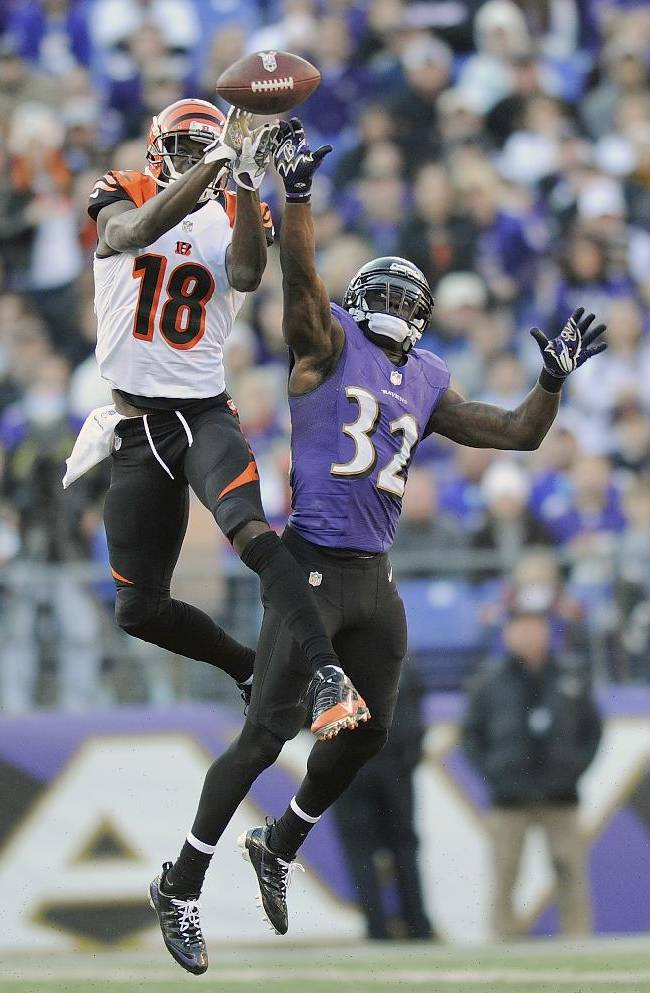 Cincinnati Bengals wide receiver A.J. Green pulls in a pass under pressure from Baltimore Ravens strong safety James Ihedigbo during the second half of a NFL football game in Baltimore, Sunday, Nov. 10, 2013