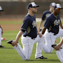 San Diego Padres pitcher Eric Stults, center, stretches with teammates before a morning work out during spring training baseball practice, Friday, Feb. 21, 2014, in Peoria, Ariz The Associated Press