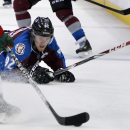Colorado Avalanche left wing Gabriel Landeskog (92), from Sweden, looks on from the ice during the second period in Game 1 of an NHL hockey first-round playoff series against the Minnesota Wild, Thursday, April 17, 2014, in Denver The Associated Press
