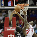 Orlando Magic power forward Glen Davis (11) has his shot blocked by Houston Rockets power forward Terrence Jones (6) as he drives to the basket during the second half of an NBA basketball game on Sunday, Dec. 8, 2013, in Houston The Associated Press
