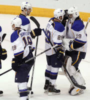 St Louis Blues goaltender Ryan Miller (39) is congratulated by teammates Steve Ott (29), Patrick Burglund, of Sweden, top center, Jay Bouwmeester (19) and Carlo Colaiacovo (13) following a 4-2 victory over the Phoenix Coyotes on Sunday, March 2, 2014, in Glendale, Ariz. Miller made his debut in goal with the Blues after being traded from the Buffalo Sabres. (AP Photo/Ralph Freso)