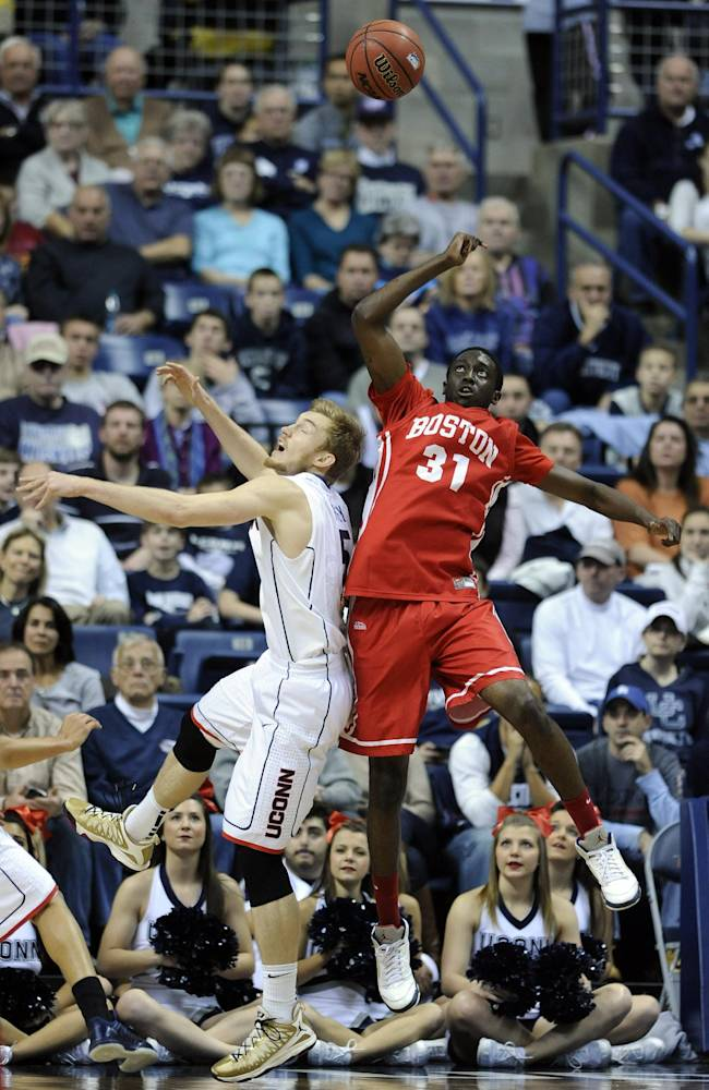 Connecticut's Niels Giffey (5) fights for a rebound with Boston University's Malik Thomas (31) during the first half of an NCAA college basketball game in Storrs, Conn., on Sunday, Nov. 17, 2013