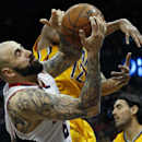 Atlanta Hawks center Pero Antic (6) pulls down a rebound against Indiana Pacers forward Evan Turner (12) in the first half of Game 4 of an NBA basketball first-round playoff series, Saturday, April 26, 2014, in Atlanta. (AP Photo/John Bazemore)