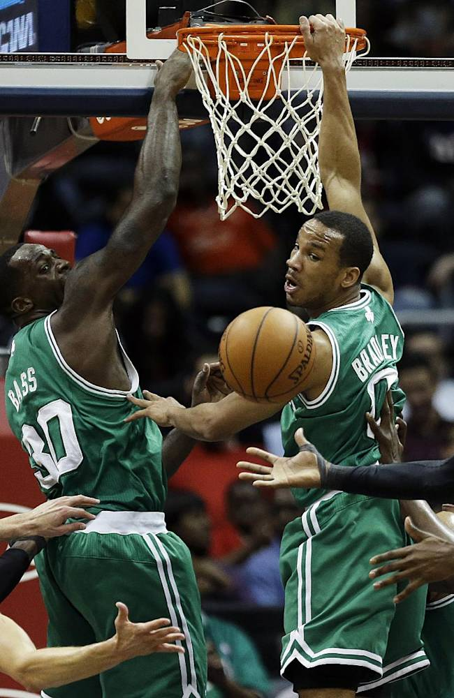 Boston Celtics' Brandon Bass and Avery Bradley, center left and right, watch a rebound fall into the hands of Atlanta Hawks' DeMarre Carroll, right, as teammates Paul Millsap, left, and Kyle Korver look on in the second quarter of an NBA basketball game, Wednesday, April 9, 2014, in Atlanta