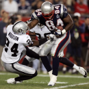In this Sept. 8, 2005 file phot, Oakland Raiders cornerback Charles Woodson, left, tries to tackle New England Patriots tight end Benjamin Watson during the first quarter of an NCAA college football game in Foxborough, Mass. The Oakland Raiders have to d