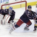 Columbus Blue Jackets' Sergei Bobrovsky, left, of Russia, makes a save as teammate James Wisniewski, center, and Nashville Pr