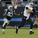 New Orleans Saints' Jimmy Graham, right, catches a pass as Carolina Panthers' Tre Boston, left, defends in the second half of an NFL football game in Charlotte, N.C., Thursday, Oct. 30, 2014 The Associated Press