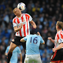 Sunderland's Wes Brown out jumps Manchester City's Sergio Aguero during the English Premier League soccer match between Manchester City and Sunderland at The Etihad Stadium, Manchester, England, Wednesday, April 16, 2014