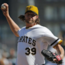 Pittsburgh Pirates relief pitcher Jason Grilli (39) delivers during the ninth inning of a baseball game against the Milwaukee Brewers in Pittsburgh Sunday, April 20, 2014. The Brewers won in 14 innings 3-2 The Associated Press