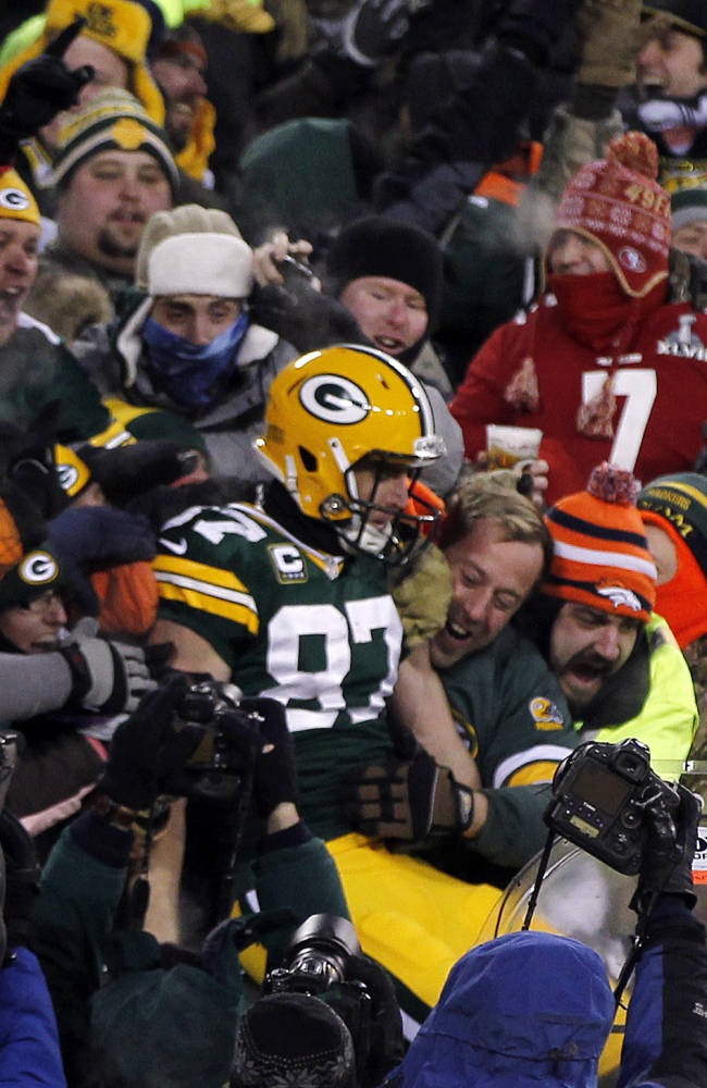 Green Bay Packers wide receiver Jordy Nelson (87) celebrates a touchdown with fans during the first half of an NFL wild-card playoff football game against the San Francisco 49ers, Sunday, Jan. 5, 2014, in Green Bay, Wis