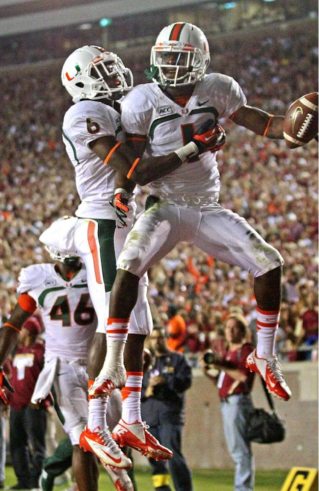 Miami's Allen Hurns, right, celebrates a second-quarter touchdown with Herb Waters against Florida State in an NCAA college football game Saturday, Nov. 2, 2013, in Tallahassee, Fla