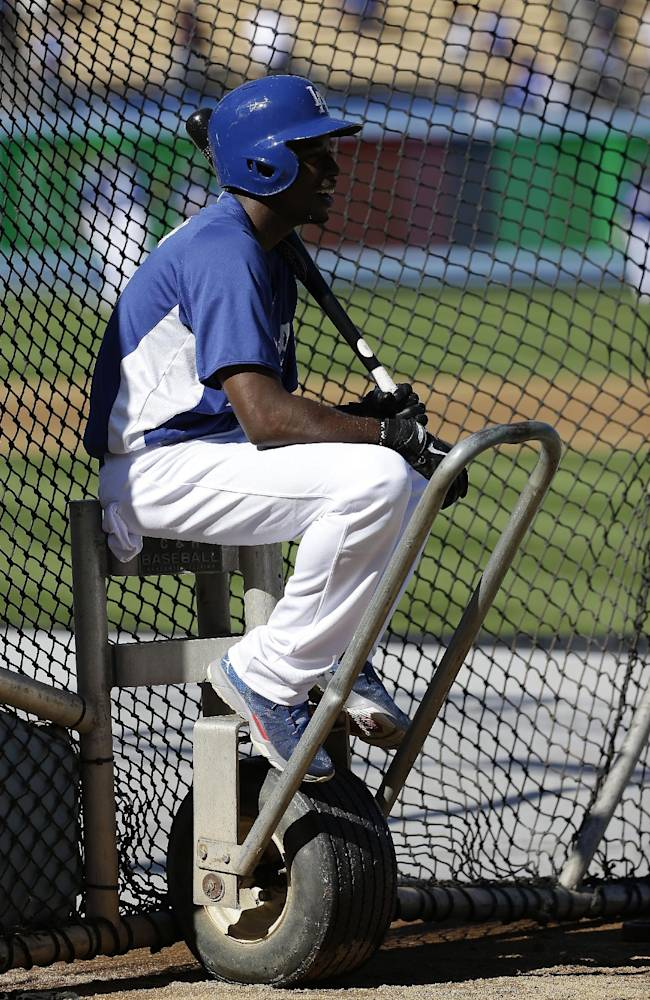 Los Angeles Dodgers' Dee Gordon waits to hit during batting practice before Game 4 of the National League baseball championship series against the St. Louis Cardinals Tuesday, Oct. 15, 2013, in Los Angeles
