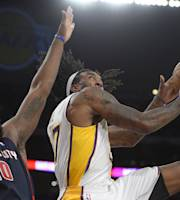 Los Angeles Lakers center Jordan Hill, right, puts up a shot as Detroit Pistons forward Greg Monroe defends during the first half of an NBA basketball game, Sunday, Nov. 17, 2013, in Los Angeles. (AP Photo/Mark J. Terrill)