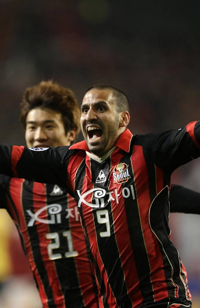 Sergio Escudero, foreground, of South Korea's FC Seoul celebrates his goal with his teammate Go Yohan after scoring against China's Guangzhou Evergrande during the first leg of the 2013 Asian Champions League final against South Korea's club FC Seoul at Seoul World Cup Stadium in Seoul, South Korea, Saturday, Oct. 26, 2013