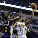 Indiana Pacers forward David West, right, shoots over Utah Jazz forward Marvin Williams during the first half of an NBA basketball game in Indianapolis, Sunday, March 2, 2014 The Associated Press