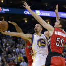 Golden State Warriors' Stephen Curry (30) scores past Toronto Raptors' Tyler Hansbrough (50) during the second half of an NBA basketball game on Tuesday, Dec. 3, 2013, in Oakland, Calif. Golden State won 112-103 The Associated Press