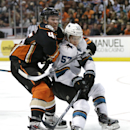 San Jose Sharks' Tommy Wingels, right, is defended by Anaheim Ducks' Sami Vatanen, of Finland, during the third period of an NHL hockey game Sunday, Oct. 26, 2014, in Anaheim, Calif. The Sharks won 4-1 The Associated Press