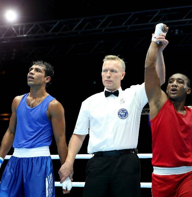 Guyana's Eon Bancroft, right, celebrates after defeating Sri Lanka's Don Maduranga Pathirage, left, in the Men's welterweight preliminaries bout at the Commonwealth Games Glasgow 2014, Glasgow, Scotland, Monday July 28, 2014