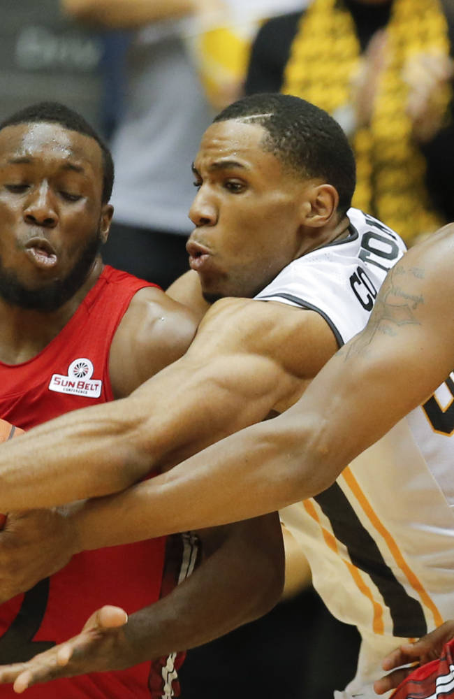 Wichita State's Tekele Cotton, center,  tries to steal the ball from Western Kentucky's T.J. Price, left, during the first half of their NCAA college basketball game early Tuesday, Nov. 12, 2013, at Charles Koch Arena in Wichita, Kan. At right is Western Kentucky's George Fant. Wichita State defeated Western Kentucky 66-49