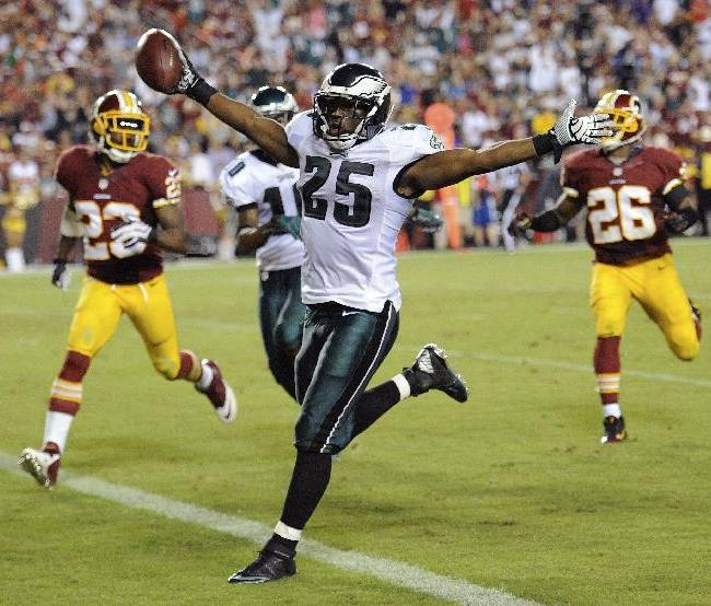 Philadelphia Eagles running back LeSean McCoy celebrates has he crosses the goal line for a touchdown during the second half of an NFL football game against the Washington Redskins in Landover, Md., Monday, Sept. 9, 2013