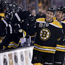 Boston Bruins center Gregory Campbell smiles as he is congratulated by teammates after his goal against the St. Louis Blues during the first period of an NHL hockey game, Thursday, Nov. 21, 2013, in Boston The Associated Press