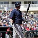 Cleveland Indians' Jason Giambi flips his bat in the air after a strike call on a pitch from Texas Rangers starter Colby Lewis in the first inning of a spring training exhibition baseball game, Monday, March 3, 2014, in Surprise , Ariz The Associated Pres