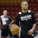 San Antonio Spurs' Tony Parker of France does drills during NBA basketball practice, Wednesday, June 5, 2013 in Miami. The Spurs play the Miami Heat in Game 1 of the NBA Finals Thursday. (AP Photo/Lynne Sladky)