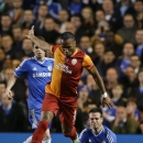 Galatasaray's Didier Drogba, left, fouls Chelsea's Cesar Azpilicueta during the Champions League round of 16 second leg soccer match between Chelsea and Galatasaray at Stamford Bridge stadium in London Tuesday, March 18, 2014