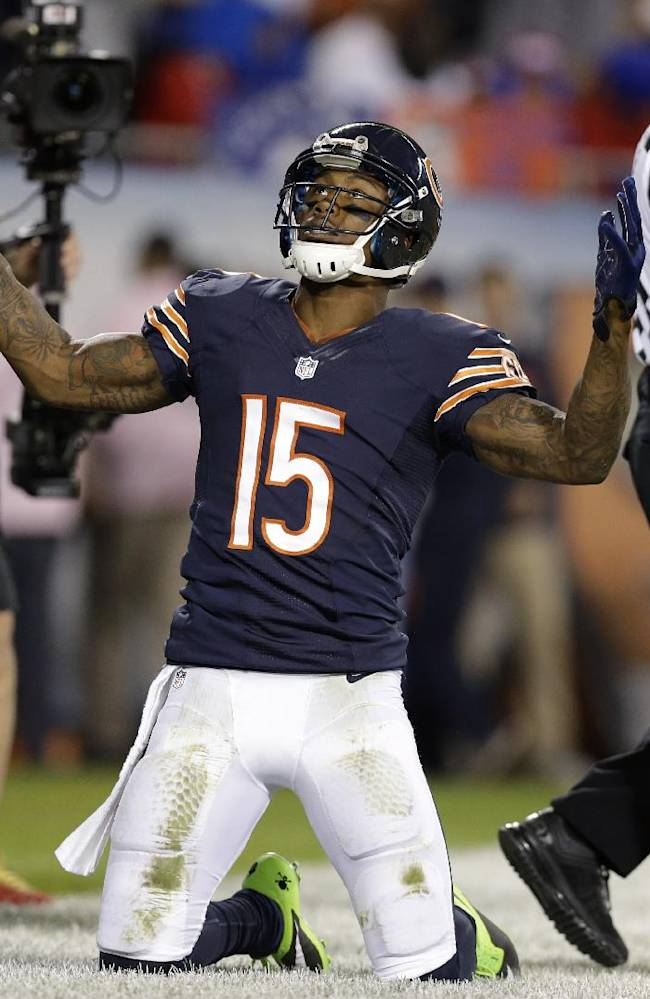Chicago Bears wide receiver Brandon Marshall (15) celebrates after making a touchdown reception in the first half of an NFL football game against the New York Giants, Thursday, Oct. 10, 2013, in Chicago