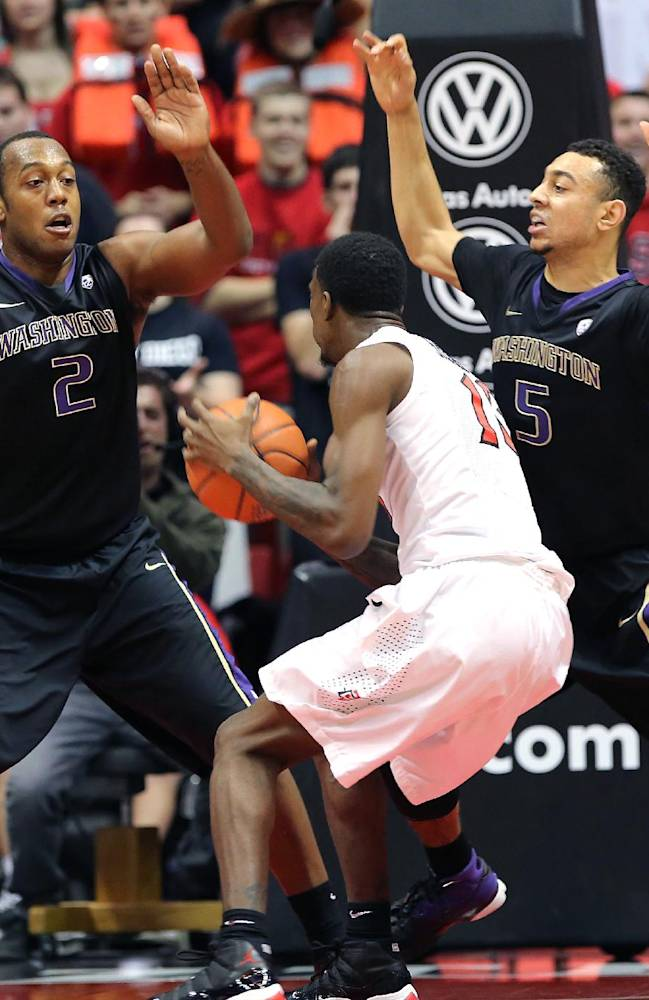 Washington's Perris Blackwell and Nigel Williams-Goss defend against San Diego's Winston Shepard as his tries to drive to the basket during the first half of an NCAA college basketball game on Sunday, Dec. 8, 2013, in San Diego