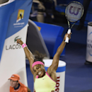 Serena Williams of the U.S. celebrates after defeating Maria Sharapova of Russia during the women's singles final at the Australian Open tennis championship in Melbourne, Australia, Saturday, Jan. 31, 2015. (AP Photo/Andy Brownbill)